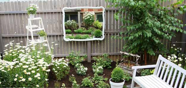 add a mirror to enlarge a small yard
